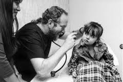 Medical Professional Examining Little Girl Ear