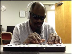 A picture of Willie Bivins using iCanConnect equipment