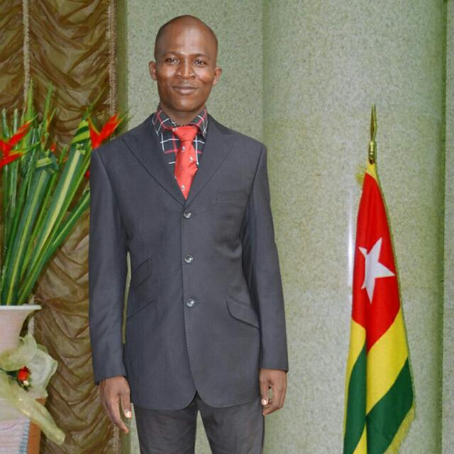 MR. KOFFI BADAGBON (Staff)