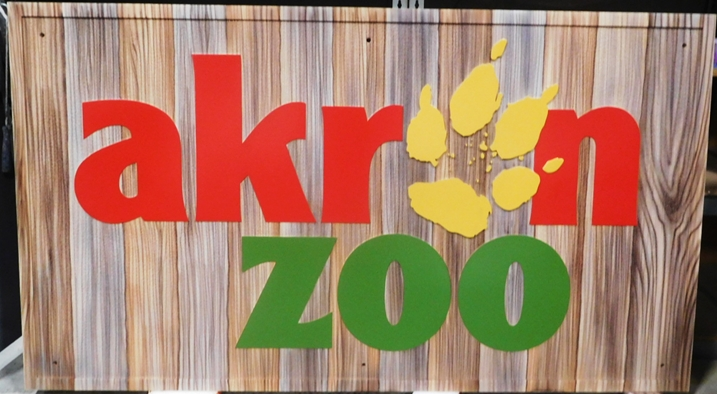 GA16490 - Large Carved High-Density-Urethane (HDU)  Sign  for Akron Zoo, with Lion Paw Print as Artwork.
