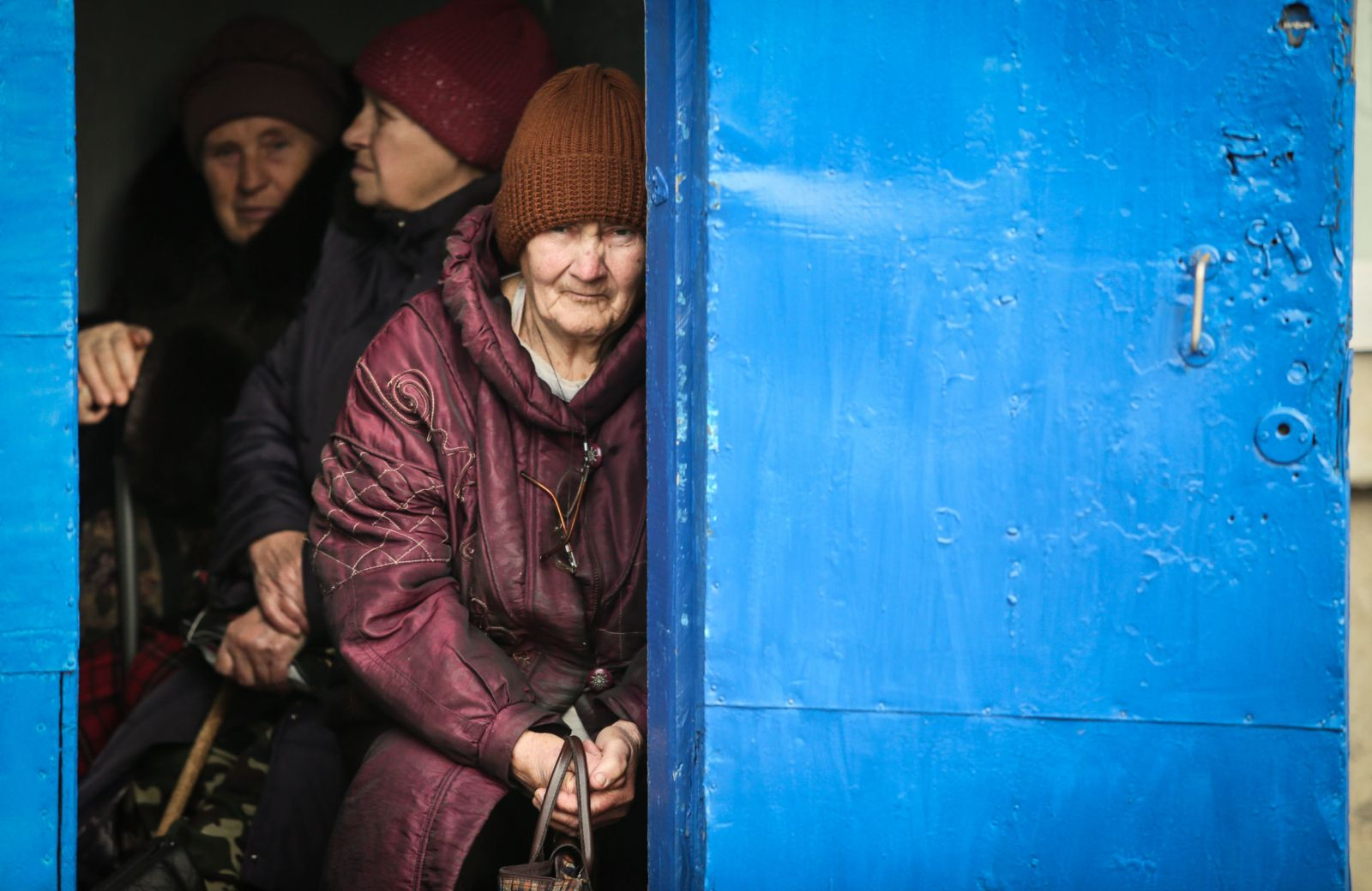 Abandoned, forgotten residents of Zolote take daily risks living at war front.