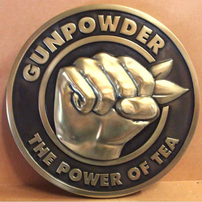 "M7155 - Brass Wall Plaque, ""Gunpowder - The Power of Tea"", with Clinched Fist"
