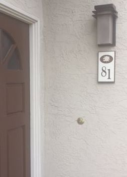 KA20930 - Apartment Number Sign Installed on Wall Adjacent to Door