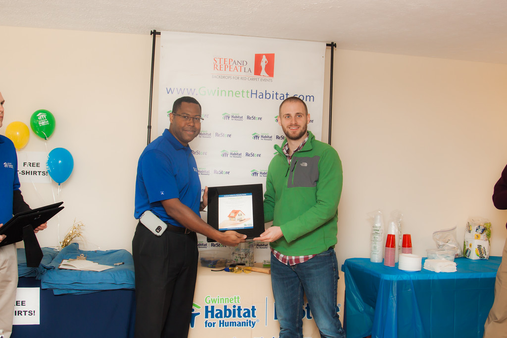 Andy presents certificate of appreciation to 12Stone Church