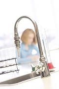 High Handled Faucet with Woman in Background