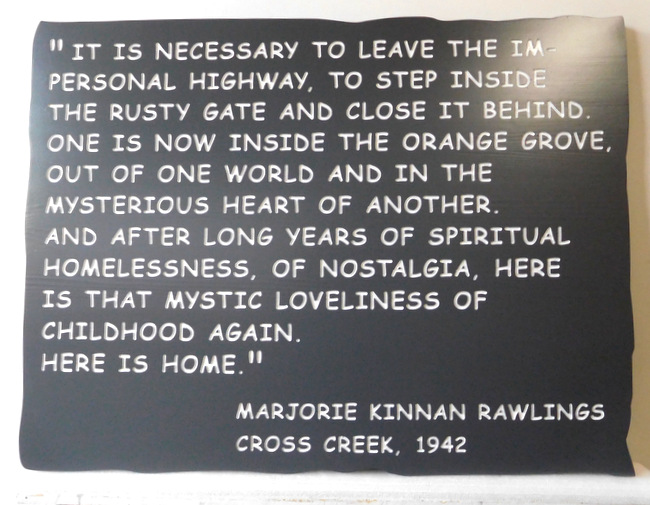 "N23177 Engraved HDU Wall Plaque with a saying by Marjorie Kinnan Rawlings  ""It is necessary to leave the impersonal highway ."""
