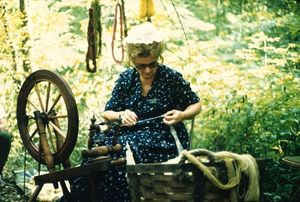 Betty Haupt demonstrates spinning flax at Mountain Craft Days