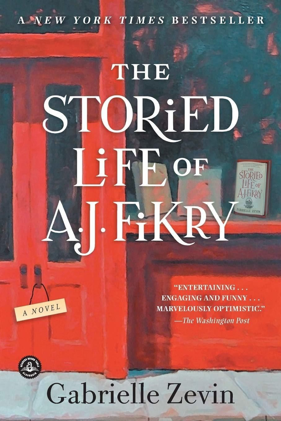 """Image of the book cover for """"The Storied Life of A.J. Fikry"""" by Gabrielle Zevin featuring the front entrance and display of a small-town bookstore."""