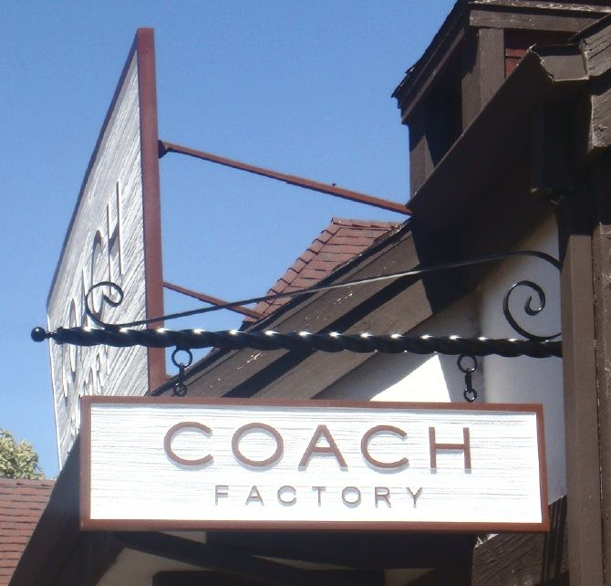 """SA28713 - Large Roof and Smaller Carved Blade Sign for the """"Coach Factory"""""""