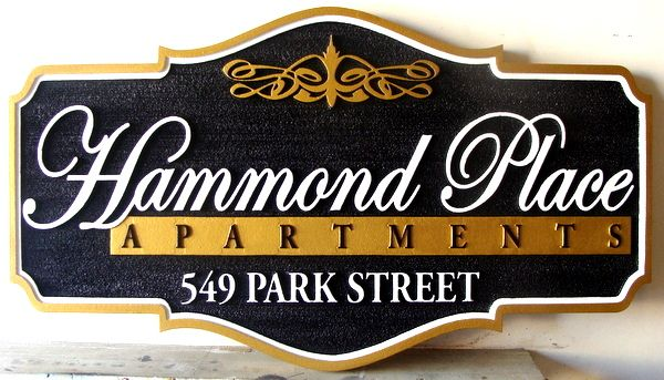 K20081- Sandblasted, Carved HDU Apartment Sign with Raised Insignia and Address