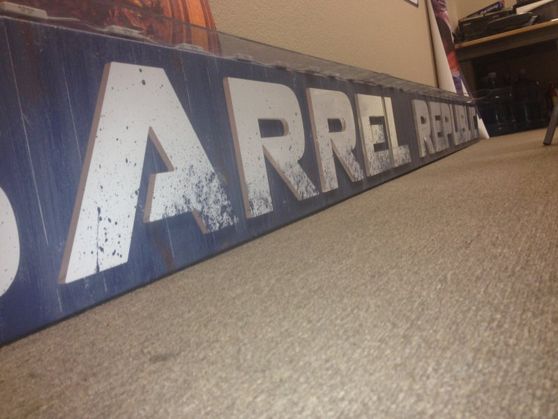 Acrylic letters pushed through routed sign.