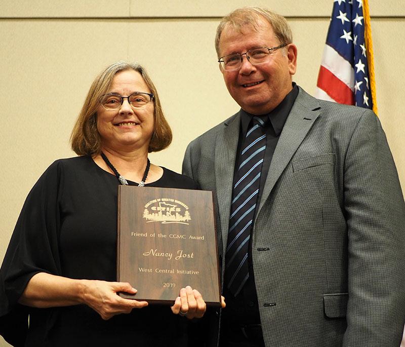 Nancy Jost receives Friend of the CGMC Award from CGMC President Ron Johnson