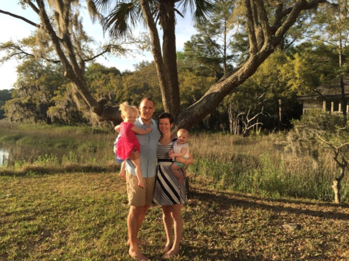 Photo of the Rose Family: Dad, Mom and two daughters standing in front of a big tree