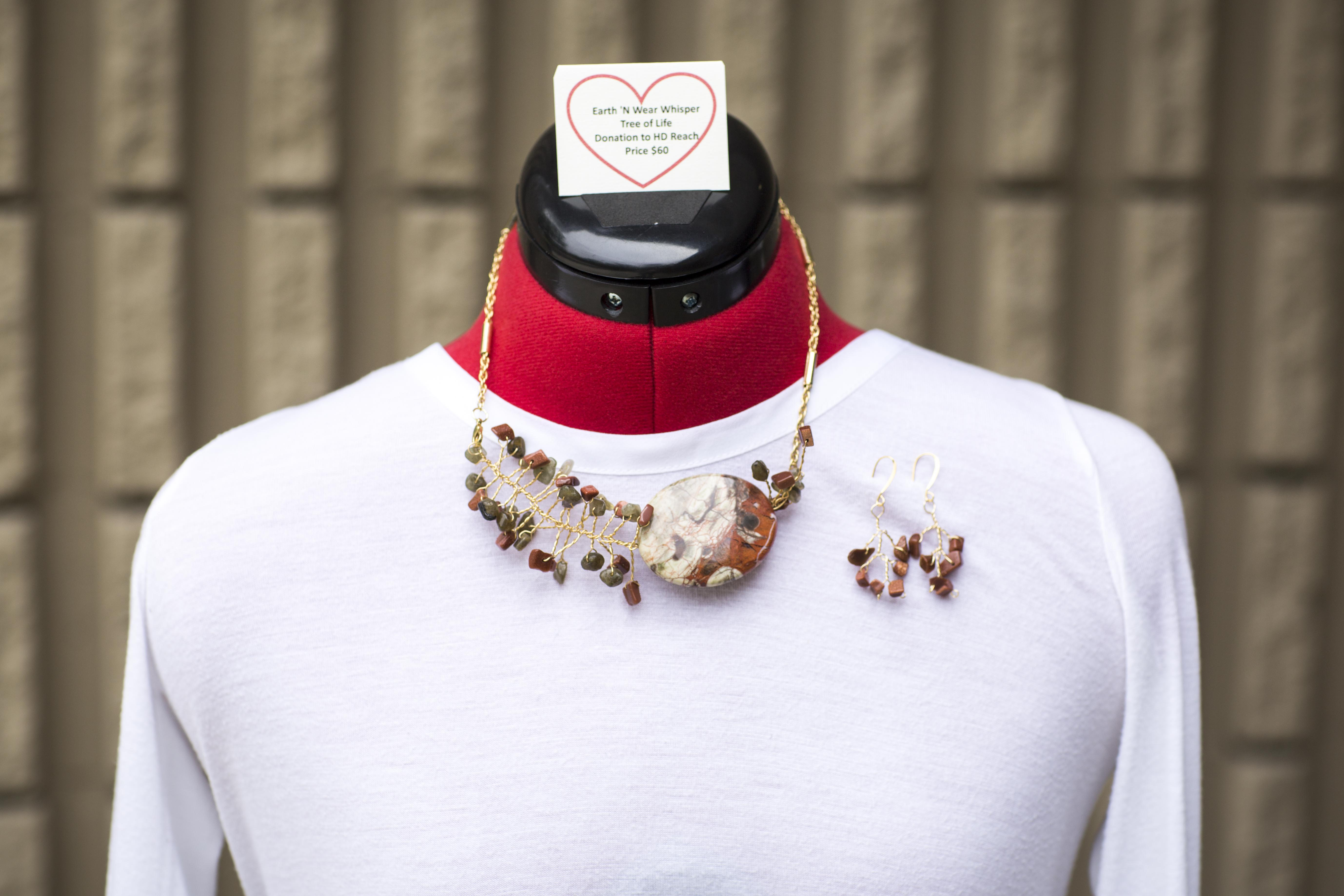 Necklace - ade and goldstone beads which are growing out of a large Mexican Laguna Jasper stone bead: promote frienship, good luck, and reducing stress.
