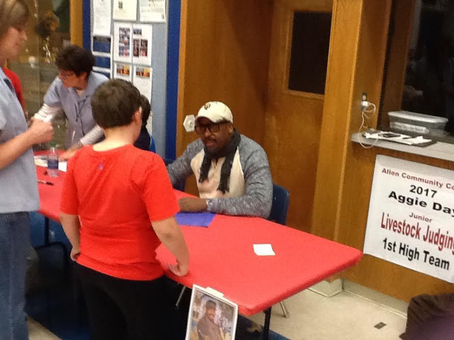 E.B. signing