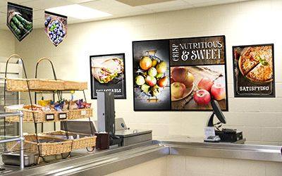 Large food murals in school café with wood look, custom signs, nutrition education