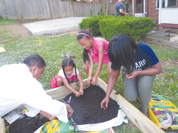 HUCM PHYSICIANS VOLUNTEER TO PLANT GARDENS AND IMPROVE CHILDHOOD NUTRITION IN SOUTHEAST DC