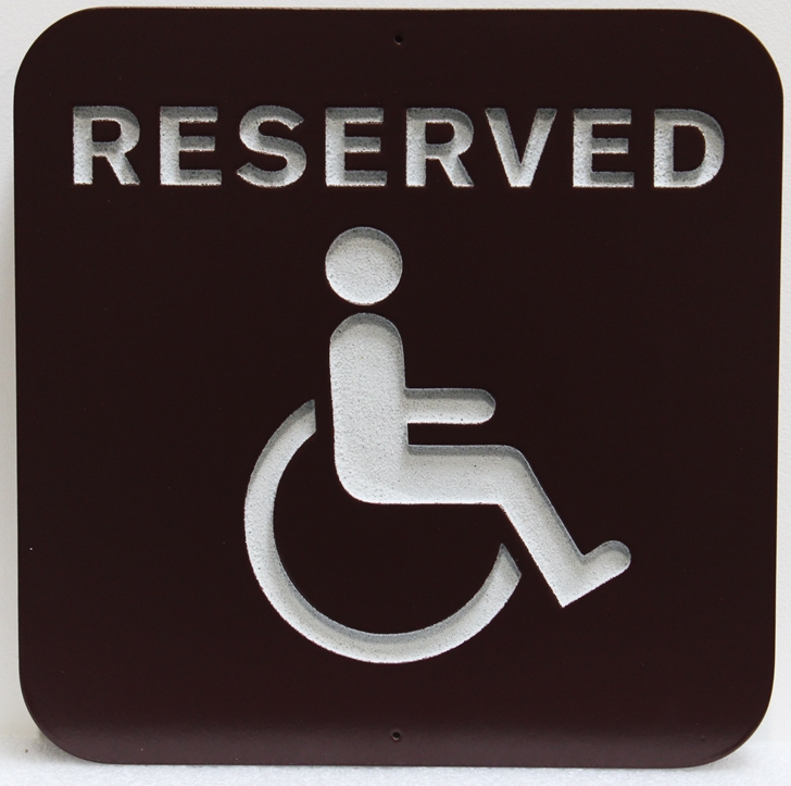 C12127 - Carved  Reserved Sign for a Handicapped Parking Space