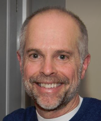 head shot portrait of Paw Print owner Tom Brassard