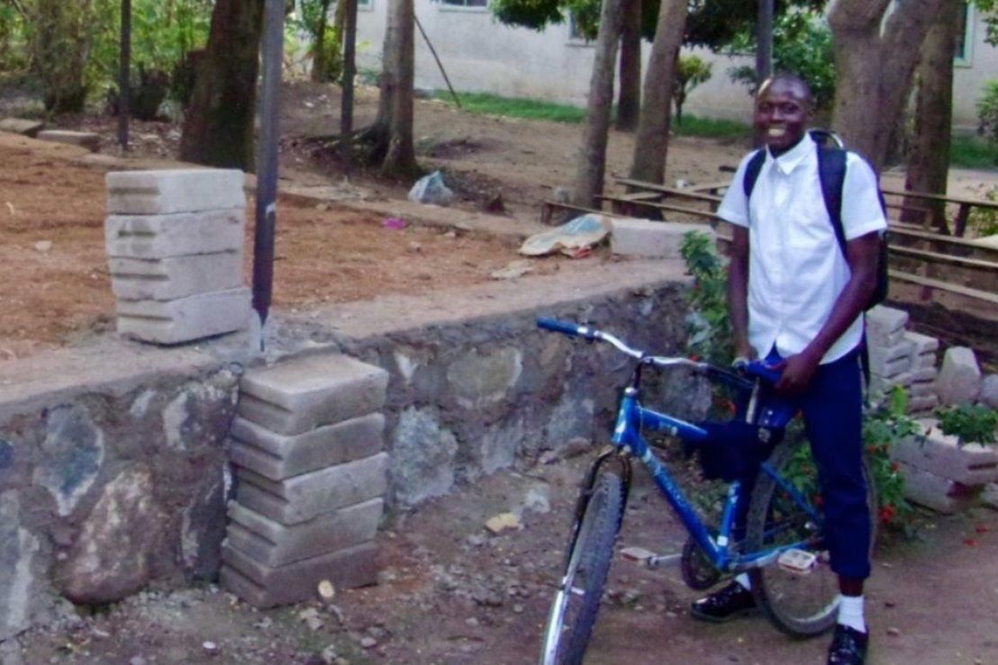 Student riding bike.