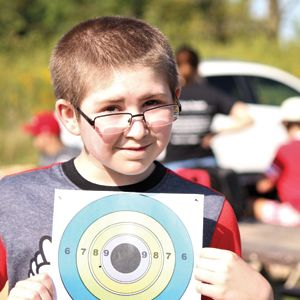 Young boy with paper target