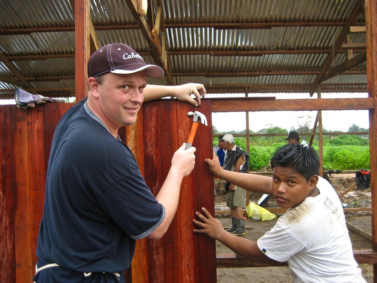 volunteers building