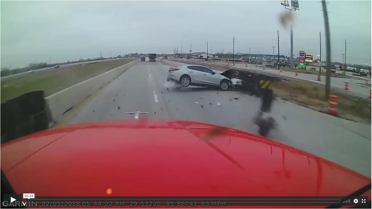 Distracted Driver Slams Into Highway Barrier