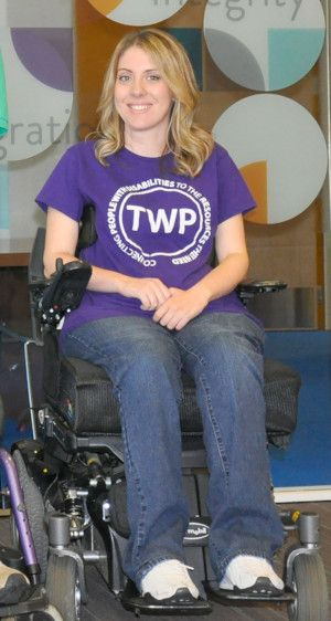 Photo of Candice Minear in purple TWP shirt