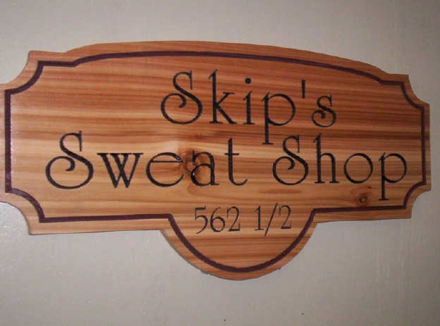 "GG701 -  Cedar  Sign, ""Skip's Sweat Shop "", with  Engraved Text and Border - $120"