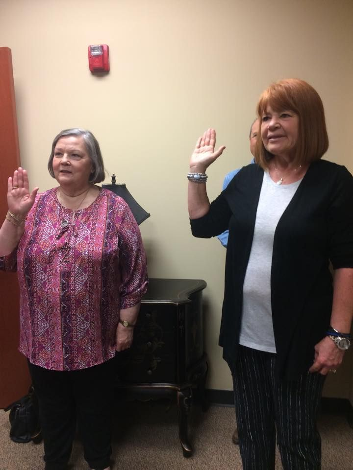 Lois and Barbara taking the Volunteer Oath