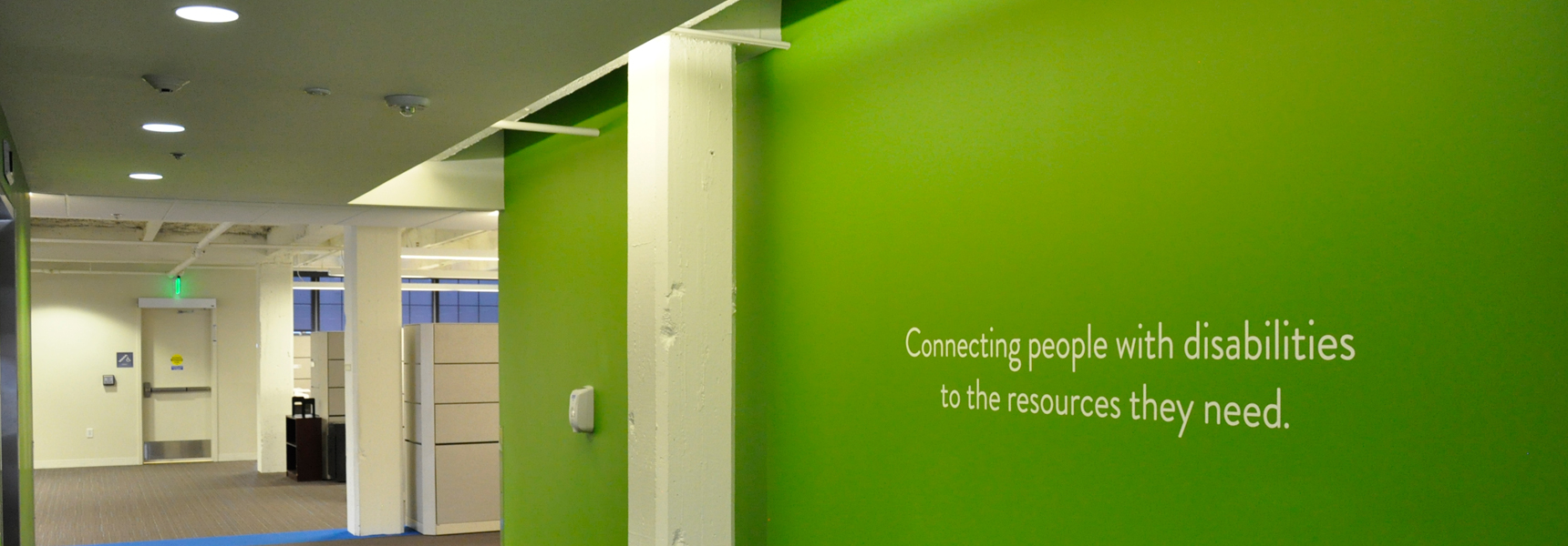 Green interior wall with TWP slogan on it