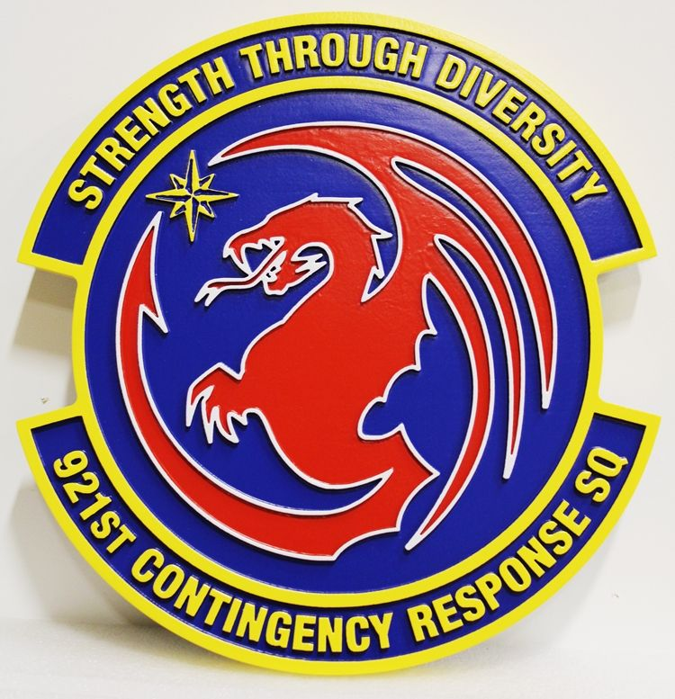 """LP-3060 - Carved Round Plaque of the Crest of the 921st Contingency Squadron """"Strength through Diversity"""""""