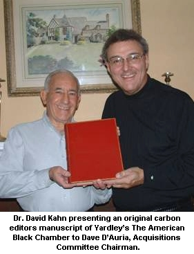Dr. David Kahn presents cryptologic items, artifacts, and memorabilia to the National Cryptologic Museum Foundation. He is pictured here with David D'Auria.