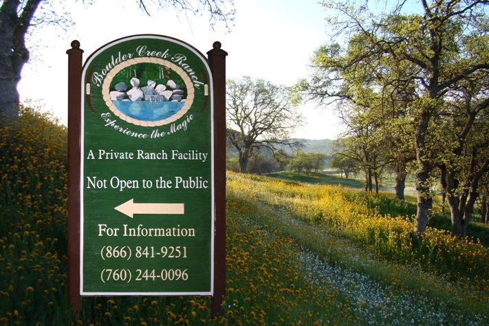 O24862 - Panel and Post Sign for Boulder Creek Ranch, with Hand-Carved Creek Scene