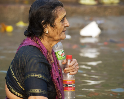 Woman Drinking the Ganges Water