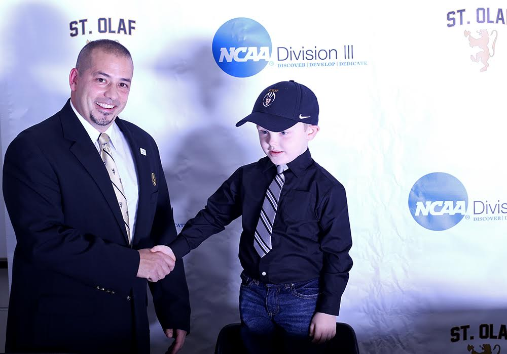 St. Olaf signs pint-sized football recruit