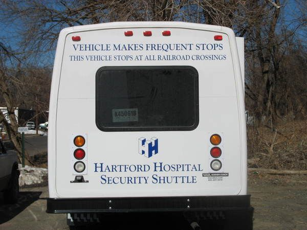 Fleet Graphics, Small Shuttle Bus, Back Side Lettering & Logo Graphics