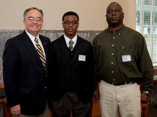 Rep. Allen Farley congratulates Michael A. Banks and his father Michael Banks