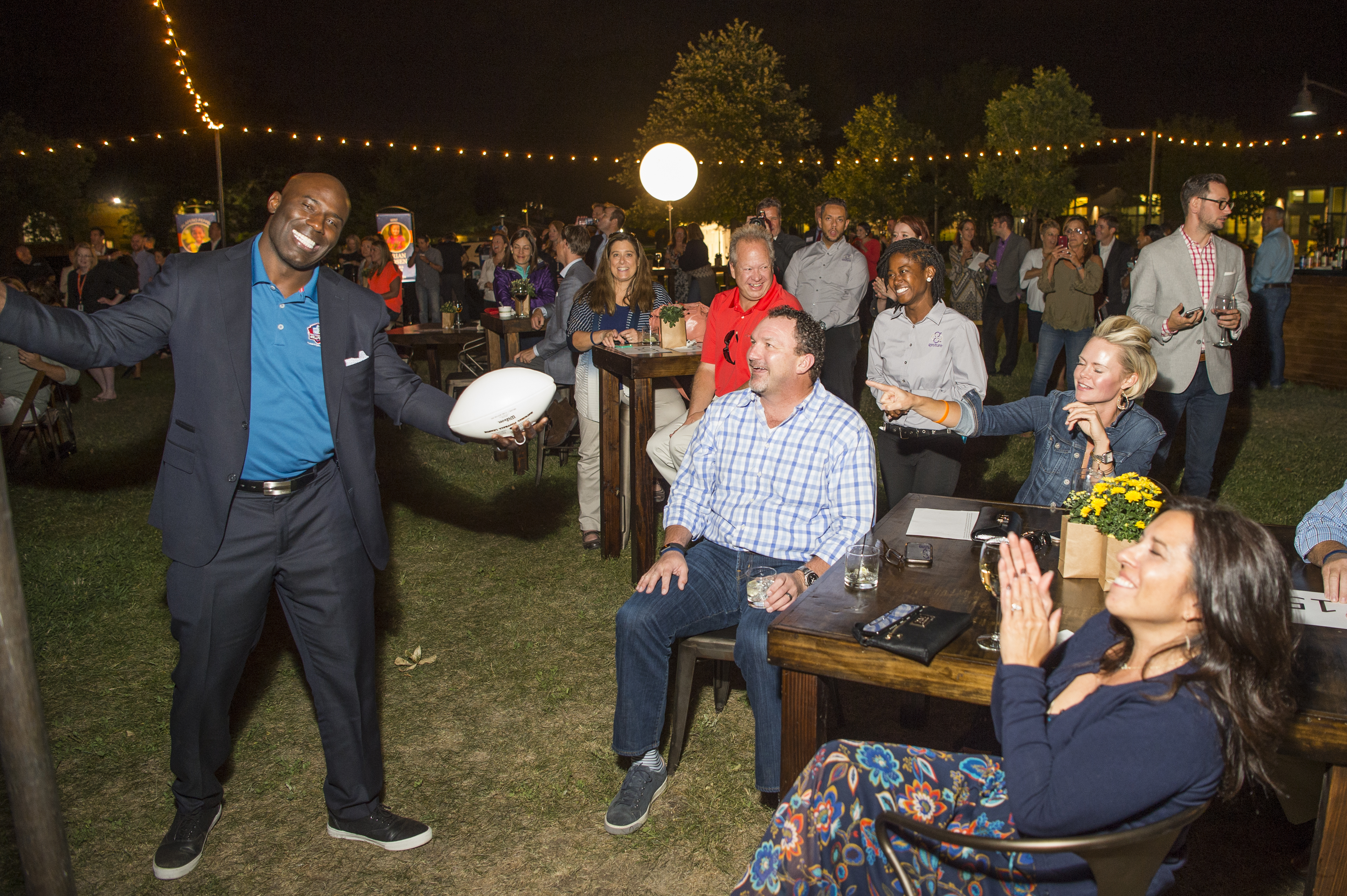 Terrell Davis has fun with guests at Moonbeam Harvest