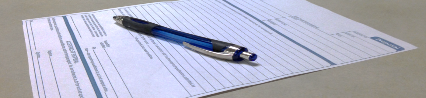 Business Form on Table with Pen