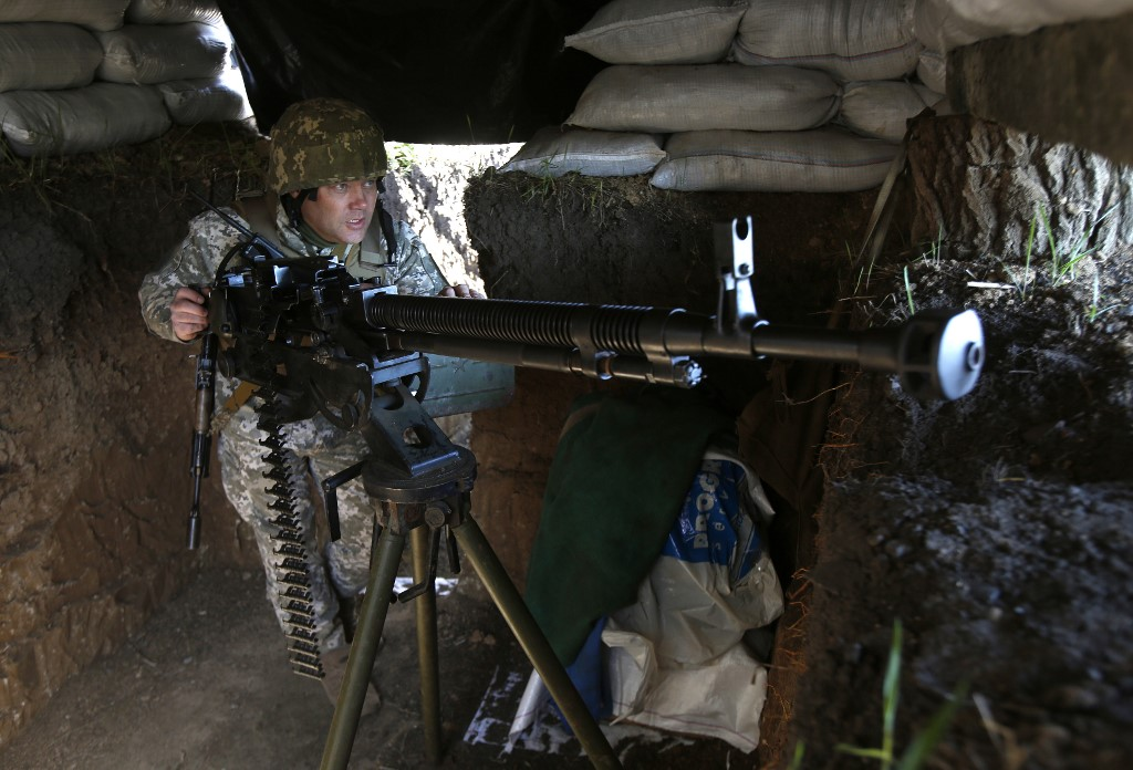 Russia-led forces attack Ukrainian positions in Donbas four times