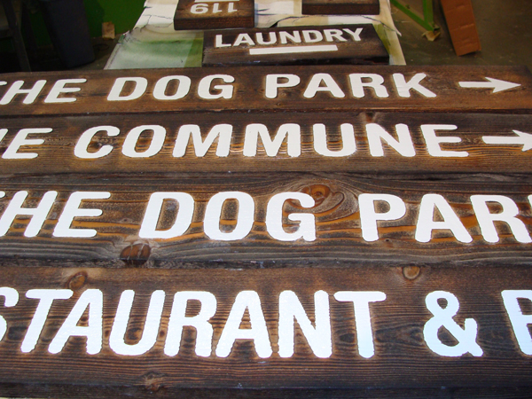 T29120 -  Rustic Carved Redwood Wayfinding Signs for a Hotel.