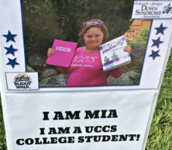 """Poster of Mia reading """"I am a UCCS college student"""""""