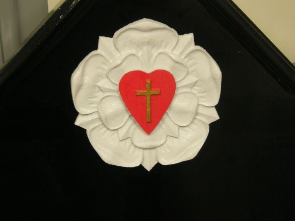 D13023 - Church Emblem for the Faith Evangelical Church, showing a 3 dimensional Carved Flower, Heart and Cross