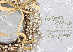 Wreath with gold bow and holiday wishes
