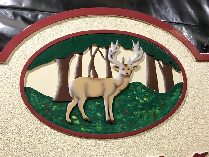 M22627 Carving of a Deer in the Woods