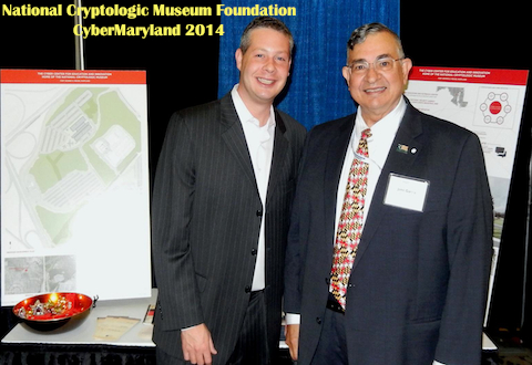 Foundation member John Garcia (right) visits CyberMaryland 2014 attendees.