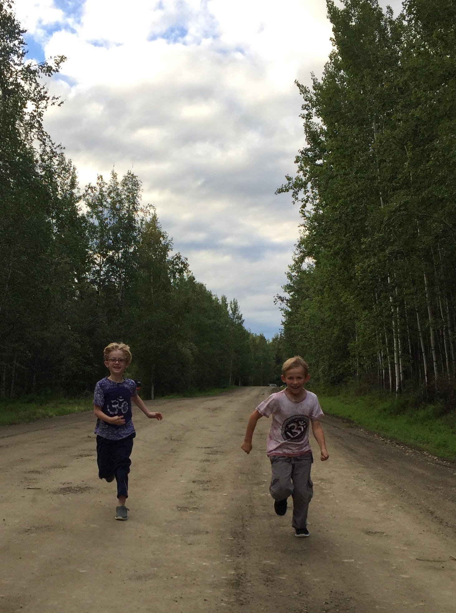 Caroline Brown's sons Galen and David running down a dirt road.
