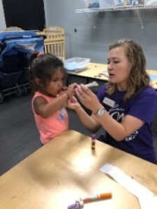 Educator working with child