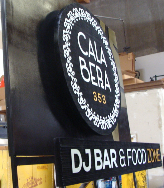 Q25735 - Side View of Cala Bera Restaurant and Bar Entrance Sign